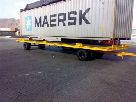 Industrial trailer for handling containers DTA