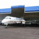 Stackable double door canvas for hangars :: CHAMPIONDOOR