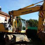 Wheel excavator :: NEW HOLLAND MH 6.6
